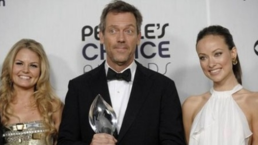 "From left, Jennifer Morrison, Hugh Laurie and Olivia Wilde pose backstage with the favorite TV drama award for ""House"" at the 35th Annual People's Choice Awards on Wednesday Jan. 7, 2009 in Los Angeles. (AP Photo/Chris Pizzello)"