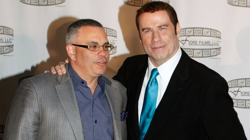 John Gotti, Jr. and John Travolta. Travolta is slated to play Gotti Sr. in an upcoming biopic.