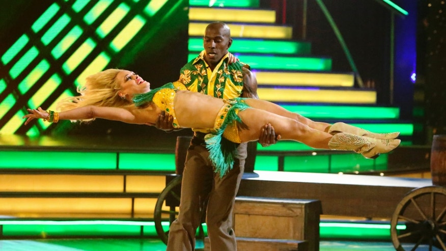"May 21, 2012: Donald Driver and his partner Peta Murgatroyd perform on the celebrity dance competition series ""Dancing with the Stars"" in Los Angeles. Driver won the mirror ball trophy Tuesday. (AP Photo/ABC, Adam Taylor)"