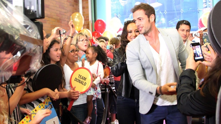 "May 23, 2012: ""Dancing With The Stars"" contestants William Levy and Cheryl Burke arrive at ABC's ""Good Morning America"" in Times Square in New York City."