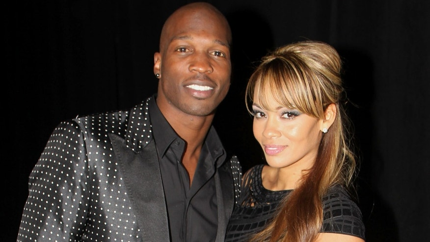 DALLAS, TX - FEBRUARY 05: NFL player Chad Ochocinco and Evelyn Lozada pose with Motorola Xoom at the Maxim Party Powered by Motorola Xoom at Centennial Hall at Fair Park on February 5, 2011 in Dallas, Texas.  (Photo by Gary Miller/Getty Images for Motorola Xoom)