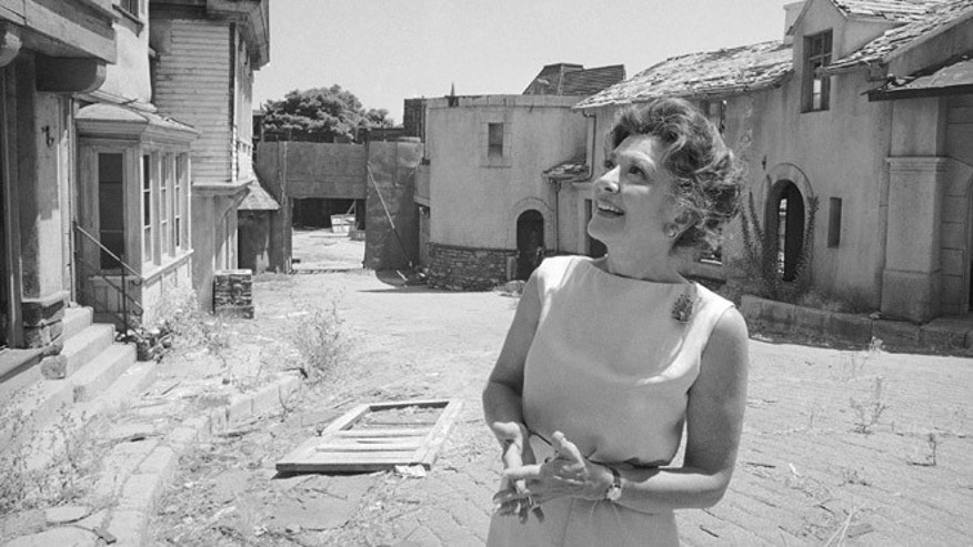 FILE - This July 26, 1972 file photo shows actress Ann Rutherford gazing at old sets on the MGM studios Lot 2 in Los Angeles where she and Mickey Rooney filmed the Andy Hardy series.