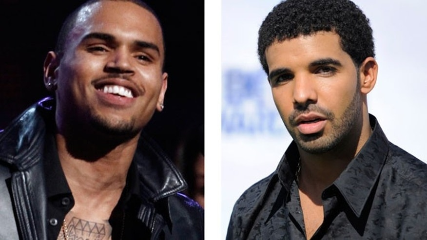 This combination of 2012 and 2011 file photos shows hip hop stars Chris Brown, left, and Drake.