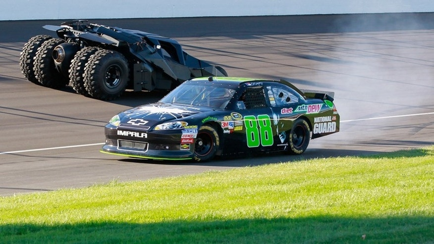 BROOKLYN, MI - JUNE 14: The No. 88 Diet Mtn Dew/The Dark Night Rises Chevy does donuts around the iconic Batman Tumbler on the front stretch at Michigan International Speedway on June 14, 2012 in Brooklyn, Michigan. (Photo By Geoff Burke/Getty Images for Mountain Dew)