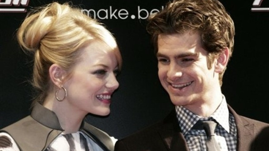 "Andrew Garfield, right, talks with Emma Stone at the world premiere of their new film ""The Amazing Spider-Man"" in Seoul, South Korea, Thursday, June 14, 2012. (AP Photo/Ahn Young-joon)"