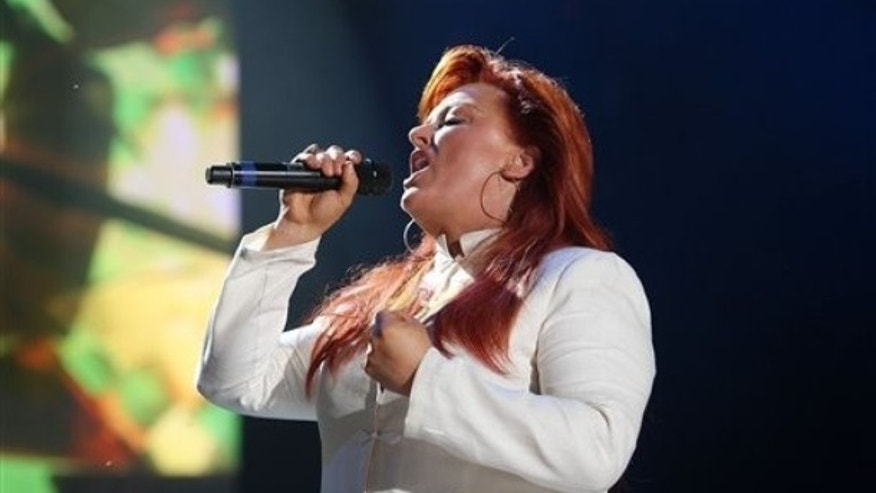 Wynonna Judd performs during the CMA Music Festival in Nashville, Tenn., Saturday, June 13, 2009. (AP Photo/Josh Anderson)