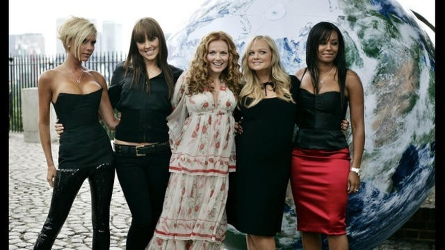 The Spice Girls pose for the photographers on the grounds of the Royal Observatory in Greenwich, London, Thursday June 28, 2007. (AP Photo/Lefteris Pitarakis)