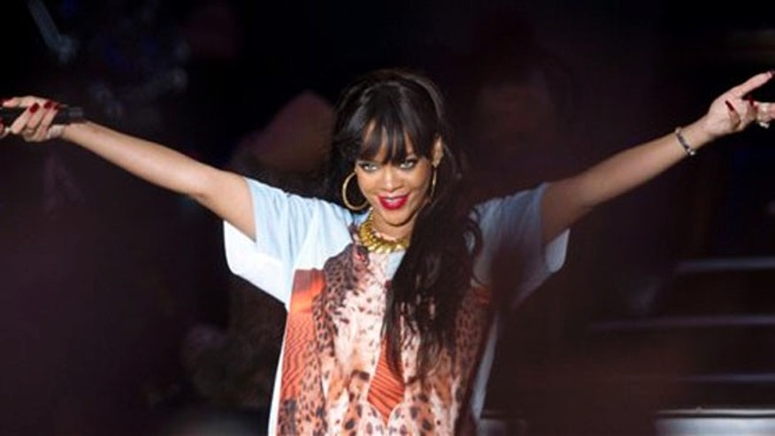 June 24, 2012: U.S singer Rihanna performs on stage at the Radio One Hackney Music Festival in Hackney marshes, east London.