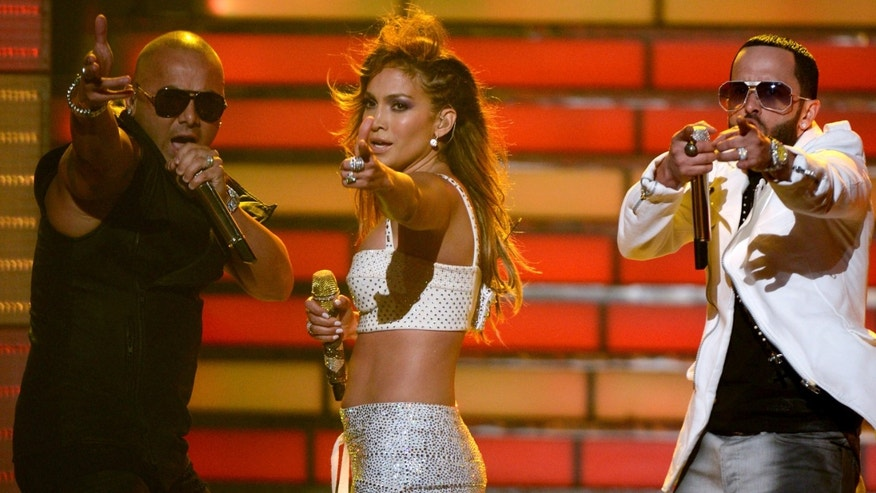 "LOS ANGELES, CA - MAY 23:  Jennifer Lopez (C) with Wisin (L) and Yandel of Wisin Y Yandel perform onstage during Fox's ""American Idol 2012"" results show at Nokia Theatre L.A. Live on May 23, 2012 in Los Angeles, California.  (Photo by Mark Davis/Getty Images)"