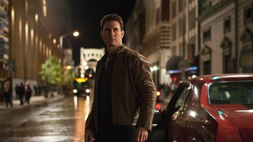 "In this publicity photo provided by Paramount Pictures, actor Tom Cruise, center, is Jack Reacher in film, ""Jack Reacher,"" from Paramount Pictures and Skydance Productions."