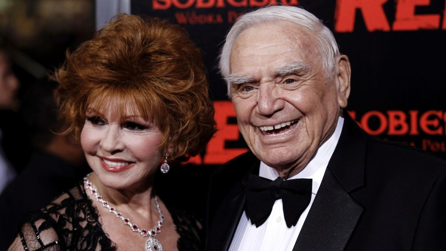 "Oct. 11, 2010: Cast member Ernest Borgnine, right, and his wife, Tova, arrive at a special screening of the film ""Red"" in Los Angeles."