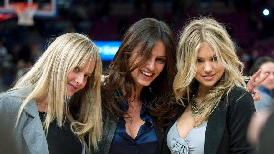 Left to right: Sports Illustrated Swimsuit models Genevieve Morton, Catrinel Menghia, and Kate Upton.