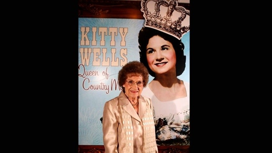 Aug. 14, 2008: This file photo originally released by the Country Music Hall of Fame and Museum shows music pioneer Kitty Wells at an exhibit honoring her career in Nashville, Tenn.