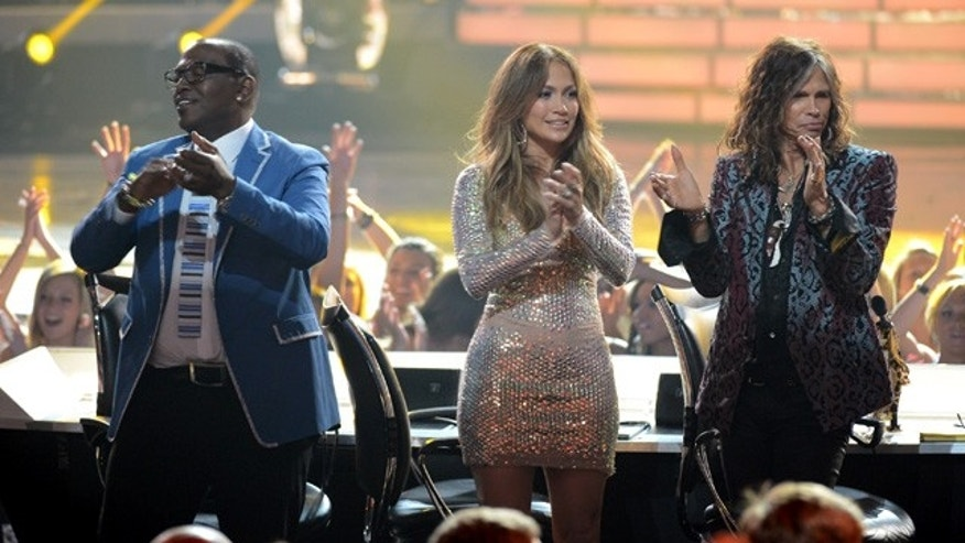 "LOS ANGELES, CA - MAY 23:  Judges Randy Jackson, Jennifer Lopez, and Steven Tyler cheer onstage during Fox's ""American Idol 2012"" results show at Nokia Theatre L.A. Live on May 23, 2012 in Los Angeles, California.  (Photo by Mark Davis/Getty Images)"