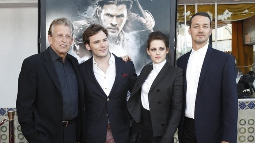 "Director of the movie Rupert Sanders (R) poses with cast members Kristen Stewart and Sam Claflin (2nd L), and producer Joe Roth at an industry screening of ""Snow White and the Huntsman."""