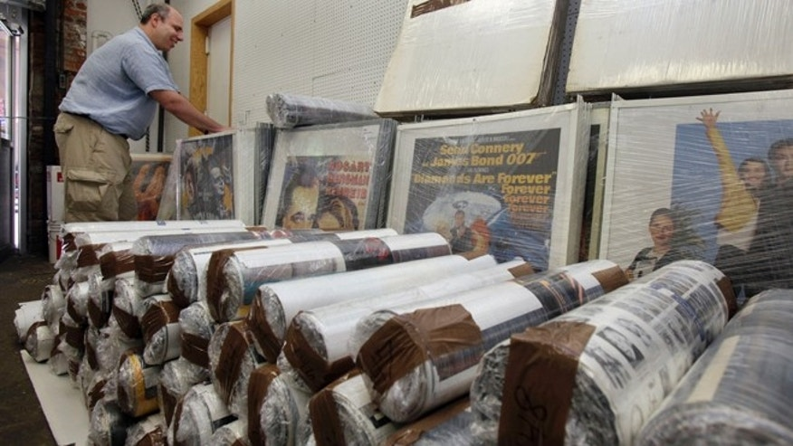 July 25, 2012: In this photo, Ira Kramer, nephew of the original Movie Star News founder Irving Klaw, looks over movie posters packed for transport, at the shop in New York.