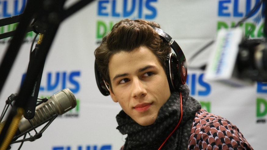 "NEW YORK, NY - JANUARY 31:  Musician and actor Nick Jonas visits ""The Elvis Duran Z100 Morning Show"" at the Z100 Studio on January 31, 2012 in New York City.  (Photo by Neilson Barnard/Getty Images)"