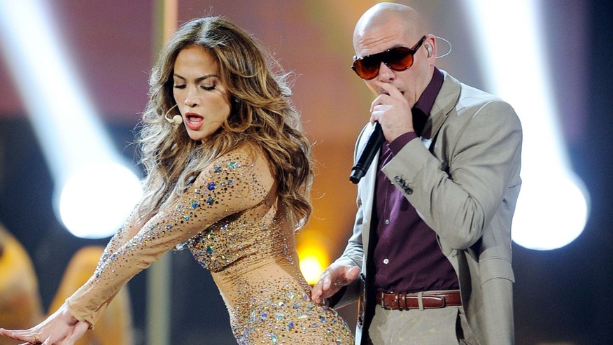 LOS ANGELES, CA - NOVEMBER 20:  Singer Jennifer Lopez and rapper Pitbull perform onstage at the 2011 American Music Awards held at Nokia Theatre L.A. LIVE on November 20, 2011 in Los Angeles, California.  (Photo by Kevork Djansezian/Getty Images)