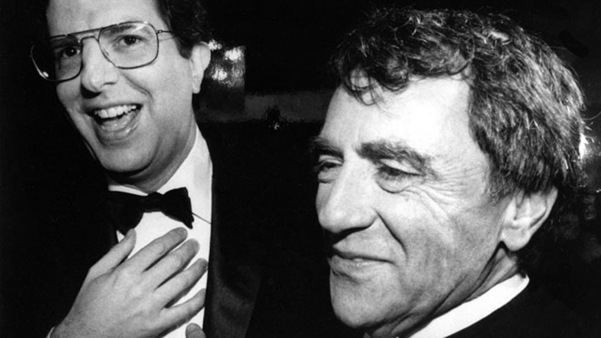 "FILE - This Oct. 12, 1983 file photo shows composer Marvin Hamlisch, left, and theatrical producer Joseph Papp at the record-breaking 3,389th performance of the musical ""A Chorus Line,"" in New York."
