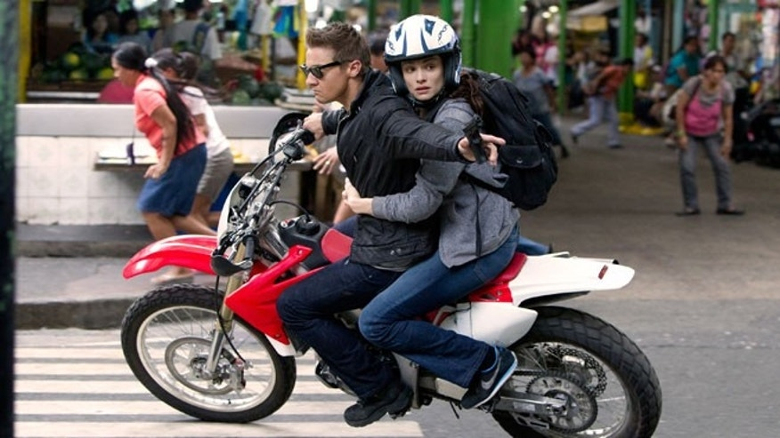 "This film image released by Universal Pictures shows Rachel Weisz as Dr. Marta Shearing, right, and Jeremy Renner as Aaron Cross in a scene from ""The Bourne Legacy."""