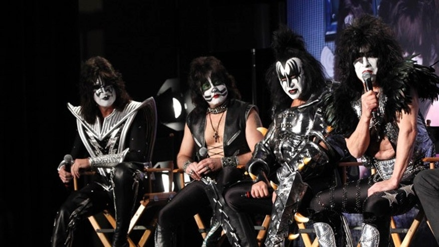 "March 20, 2012: Rock band Kiss (from L-R) Tommy Thayer, Eric Singer, Gene Simmons and Paul Stanley attend a news conference to announce the ""Kiss, Motley Crue: The Tour"" in Hollywood, California."