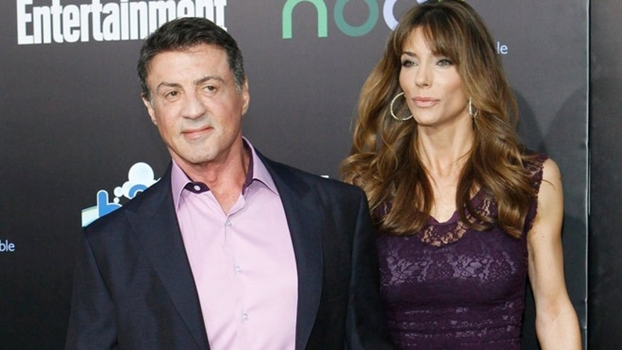"Sylvester Stallone and his wife Jennifer Flavin pose at the premiere of ""The Hunger Games"" in Los Angeles on March 12, 2012."