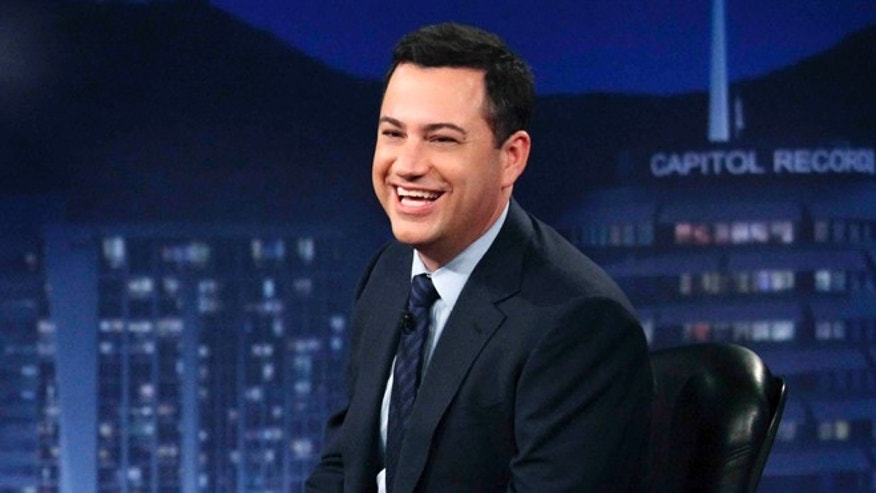 "This July 25, 2012 photo released by ABC shows Jimmy Kimmel hosting his late night show ""Jimmy Kimmel Live,"" in the Hollywood section of Los Angeles."