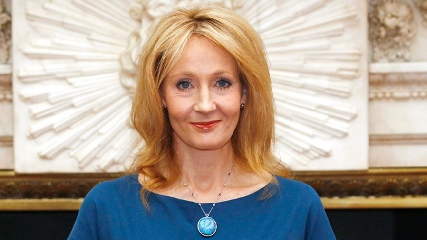 May 8, 2012: Author J.K. Rowling poses for photos with her certificate at Mansion House after being presented with the Freedom of the City of London.