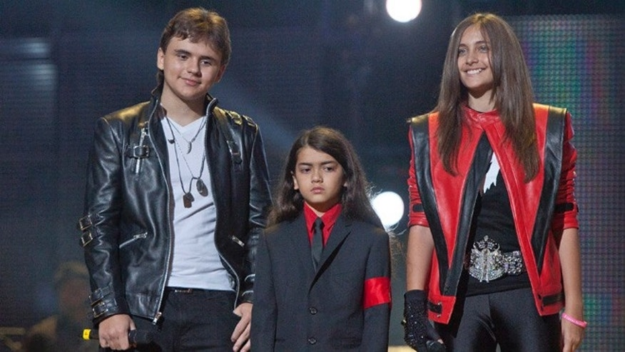 "Oct. 8, 2011: In this file photo, from left, Prince Jackson, Prince Michael II ""Blanket""Jackson and Paris Jackson arrive on stage at the Michael Forever the Tribute Concert, at the Millennium Stadium in Cardiff, Wales."