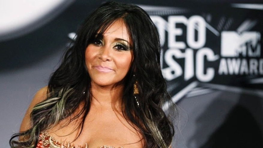 "Aug. 28, 2011: Nicole ""Snooki"" Polizzi from the MTV reality series ""Jersey Shore"" poses at the 2011 MTV Video Music Awards in Los Angeles."