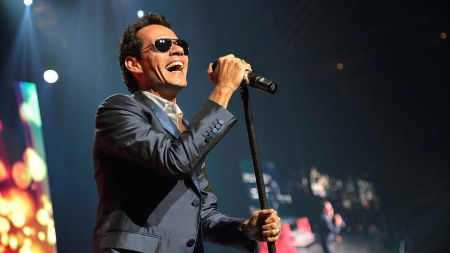 EAST RUTHERFORD, NJ - AUGUST 10:  Singer Marc Anthony performs at Izod Center on August 10, 2012 in East Rutherford, New Jersey.  (Photo by Mike Coppola/Getty Images)