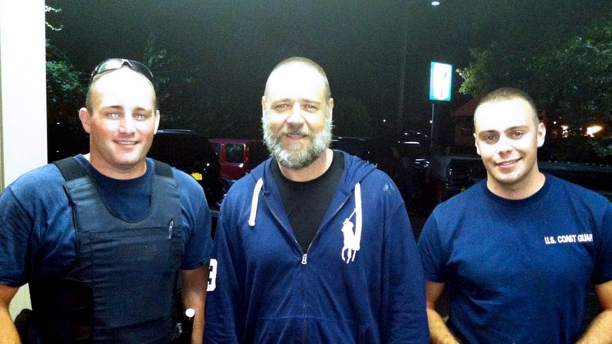 Sept. 2, 2012: A photo provided by the U.S. Coast Guard  shows Russell Crowe, center, with Coast Guard petty officers  Robert Swieciki, left,  and Thomas Watson.