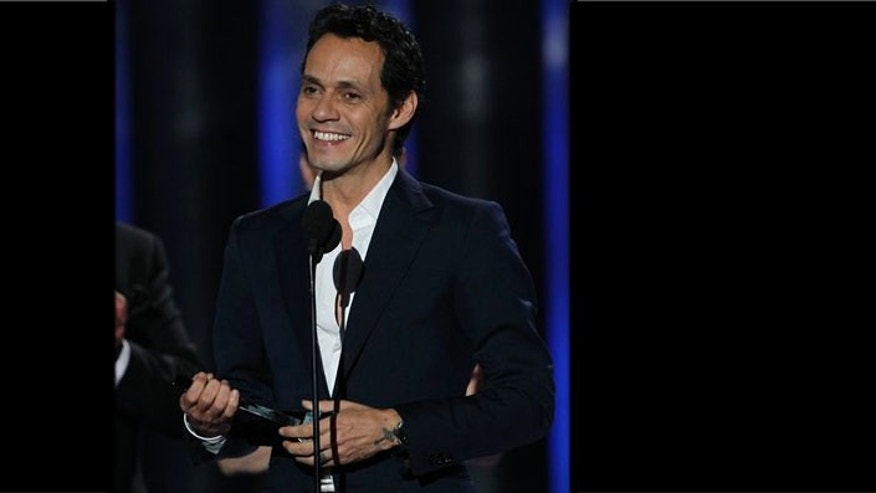 Singer Marc Anthony accepts the Billboard Hall of Fame award during the Latin Billboard Awards in Coral Gables, Fla., Thursday April 26, 2012. (AP Photo/Lynne Sladky)