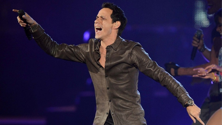 LAS VEGAS, NV - MAY 26:  Singer Marc Anthony performs during the Q'Viva! The Chosen Live show at the Mandalay Bay Events Center on May 26, 2012 in Las Vegas, Nevada.  (Photo by Ethan Miller/Getty Images)