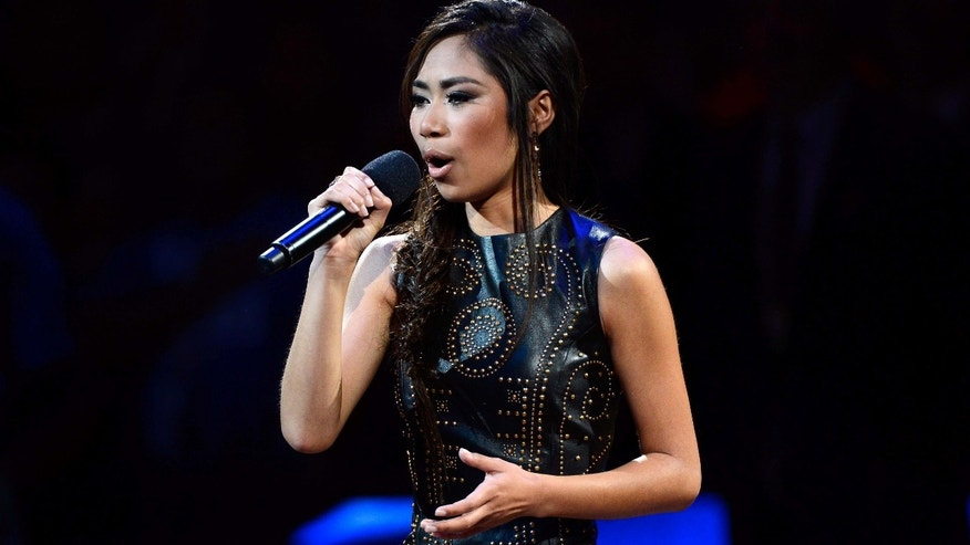 OKLAHOMA CITY, OK - JUNE 12:  Singer Jessica Sanchez performs the national anthem before Game One of the 2012 NBA Finals between the Oklahoma City Thunder and the Miami Heat at Chesapeake Energy Arena on June 12, 2012 in Oklahoma City, Oklahoma. NOTE TO USER: User expressly acknowledges and agrees that, by downloading and or using this photograph, User is consenting to the terms and conditions of the Getty Images License Agreement.  (Photo by Ronald Martinez/Getty Images)