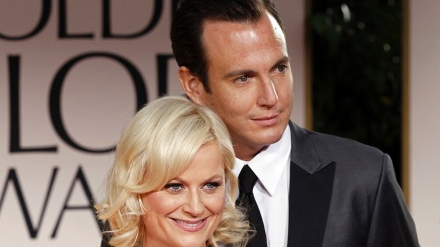 Jan. 15, 2012: Actors Amy Poehler, left, and Will Arnett arrive at the 69th Annual Golden Globe Awards in L.A.