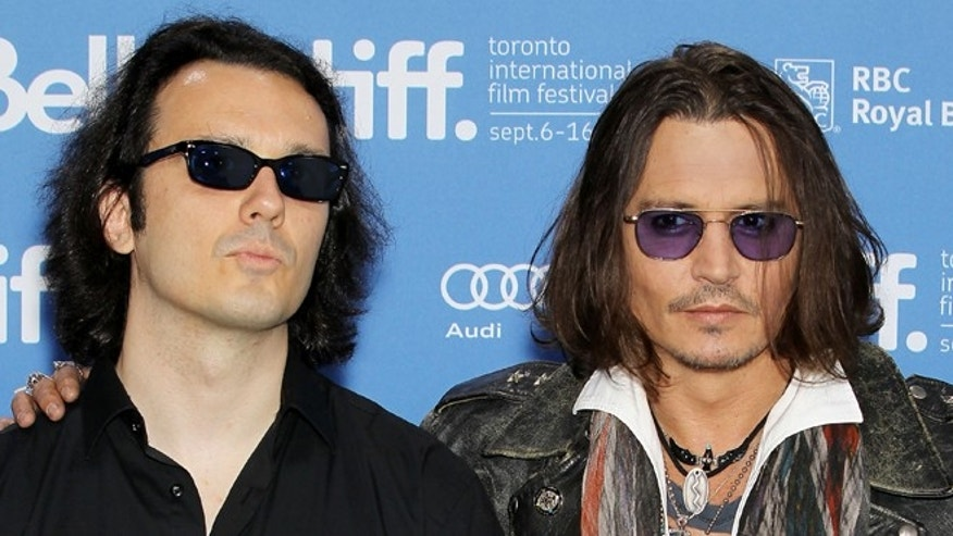 "Sept. 8, 2012: This image released by Starpix shows Damien Echols, one of the West Memphis Three, left, and actor Johnny Depp at a press conference for the film ""West of Memphis"" at the 2012 Toronto International Film Festival in Toronto."