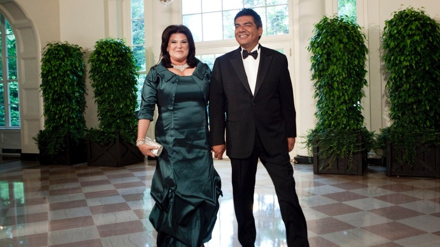 WASHINGTON - MAY 19:  Comedian George Lopez (R) and Ann M. Lopez arrive at the White House for a state dinner May 19, 2010 in Washington, DC.  President Barack Obama and first lady Michelle Obama are hosting Mexican President Felipe Calderon and his wife Margarita Zavala for a state dinner during their visit to the United States.   (Photo by Brendan Smialowski/Getty Images)