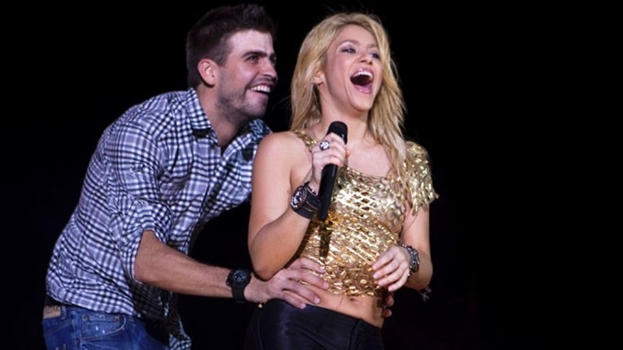 May 29, 2011: This file photo shows Colombia's singer Shakira performs with FC Barcelona Gerard Pique during The Sun Comes Out World Tour concert in Barcelona, Spain.