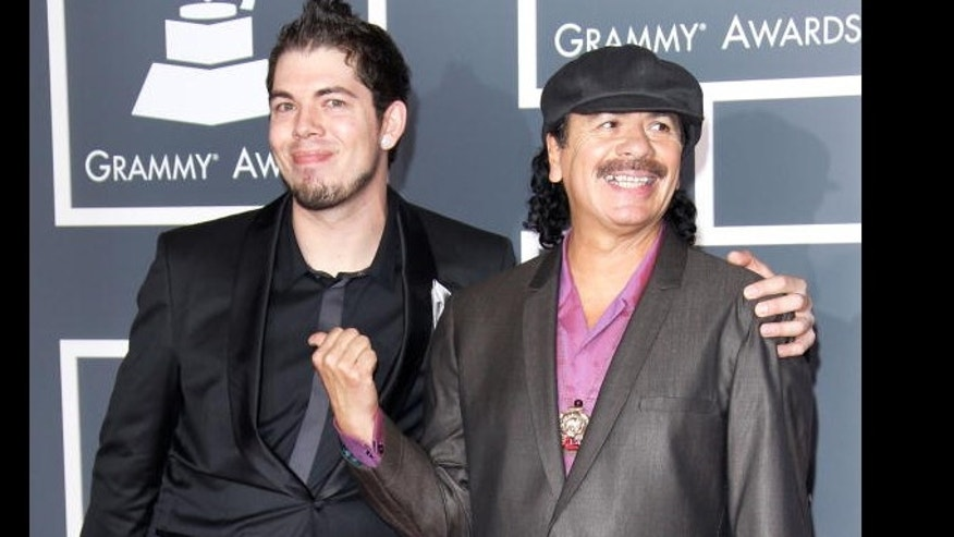 Salvador Santana, left, and his father Carlos Santana, right, arrive at the 52nd Annual GRAMMY Awards held at Staples Center in 2010 in Los Angeles, California. Salvador grew up around music, but has carved his own artistic style.