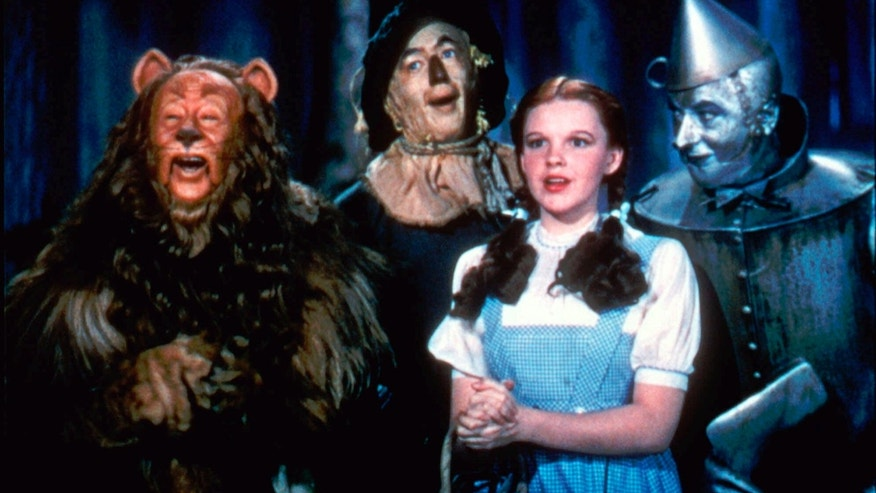 "Bert Lahr as the Cowardly Lion, Ray Bolger as the Scarecrow, Judy Garland as Dorothy and Jack Haley as the Tin Woodman in a scene from ""The Wizard of Oz."""