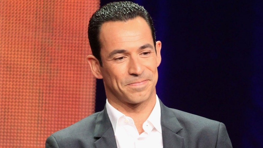 "BEVERLY HILLS, CA - JULY 27:  Dancer Helio Castroneves speaks onstage at the ""Dancing with the Stars: All-Stars"" panel during the Disney/ABC Television Group portion of the 2012 Summer TCA Tour on July 27, 2012 in Beverly Hills, California.  (Photo by Frederick M. Brown/Getty Images)"