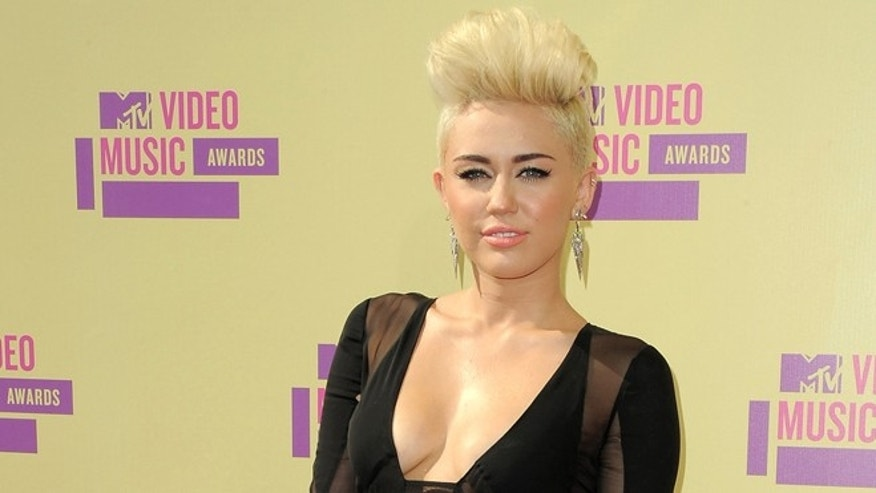 Sept. 6, 2012: In this file photo, Miley Cyrus attends the MTV Video Music Awards in Los Angeles.