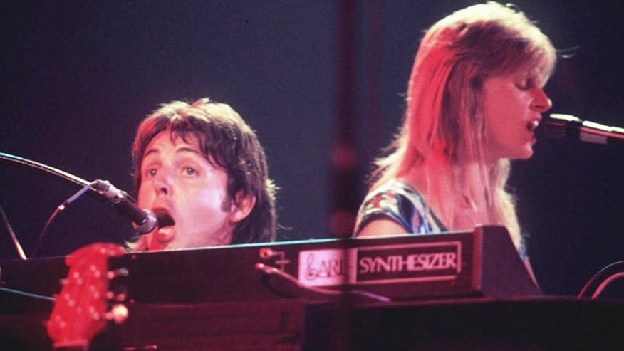 "Bond's producer suggested Paul McCartney's vocal be replaced on 'Live and Let Die,"" thinking he was just a demo singer. Here McCartney sings with his late wife Linda in their band Wings."