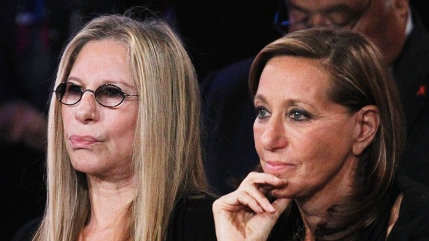 Barbra Streisand and designer Donna Karan at a political event.