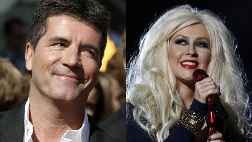 Simon Cowell thinks 'The Voice; which counts Christina Aguilera among its judges, is a ripoff of his shows.