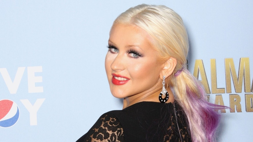 PASADENA, CA - SEPTEMBER 16:  Actress Christina Aguilera arrives at the 2012 NCLR ALMA Awards at Pasadena Civic Auditorium on September 16, 2012 in Pasadena, California.  (Photo by Frederick M. Brown/Getty Images)