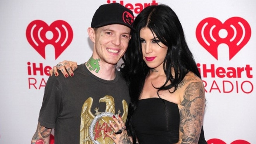 LAS VEGAS, NV - SEPTEMBER 22:  (L-R) Recording artist Joel Zimmerman aka Deadmau5 and television personality Kat Von D pose in the press room at the iHeartRadio Music Festival at the MGM Grand Garden Arena September 21, 2012 in Las Vegas, Nevada.  (Photo by Steven Lawton/Getty Images)