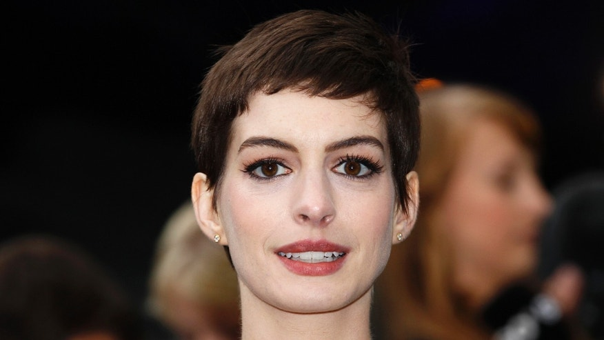 Actress Anne Hathaway poses for photographers as she arrives at a premiere in London.