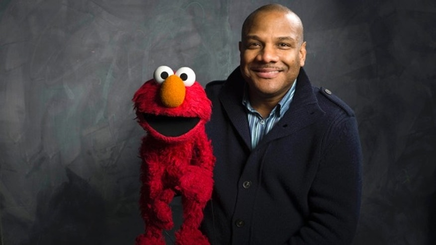 "Jan. 24, 2011: This photo shows ""Sesame Street"" muppet Elmo and puppeteer Kevin Clash poses for a portrait in the Fender Music Lodge during the 2011 Sundance Film Festival to promote the film ""Being Elmo"" in Park City, Utah."